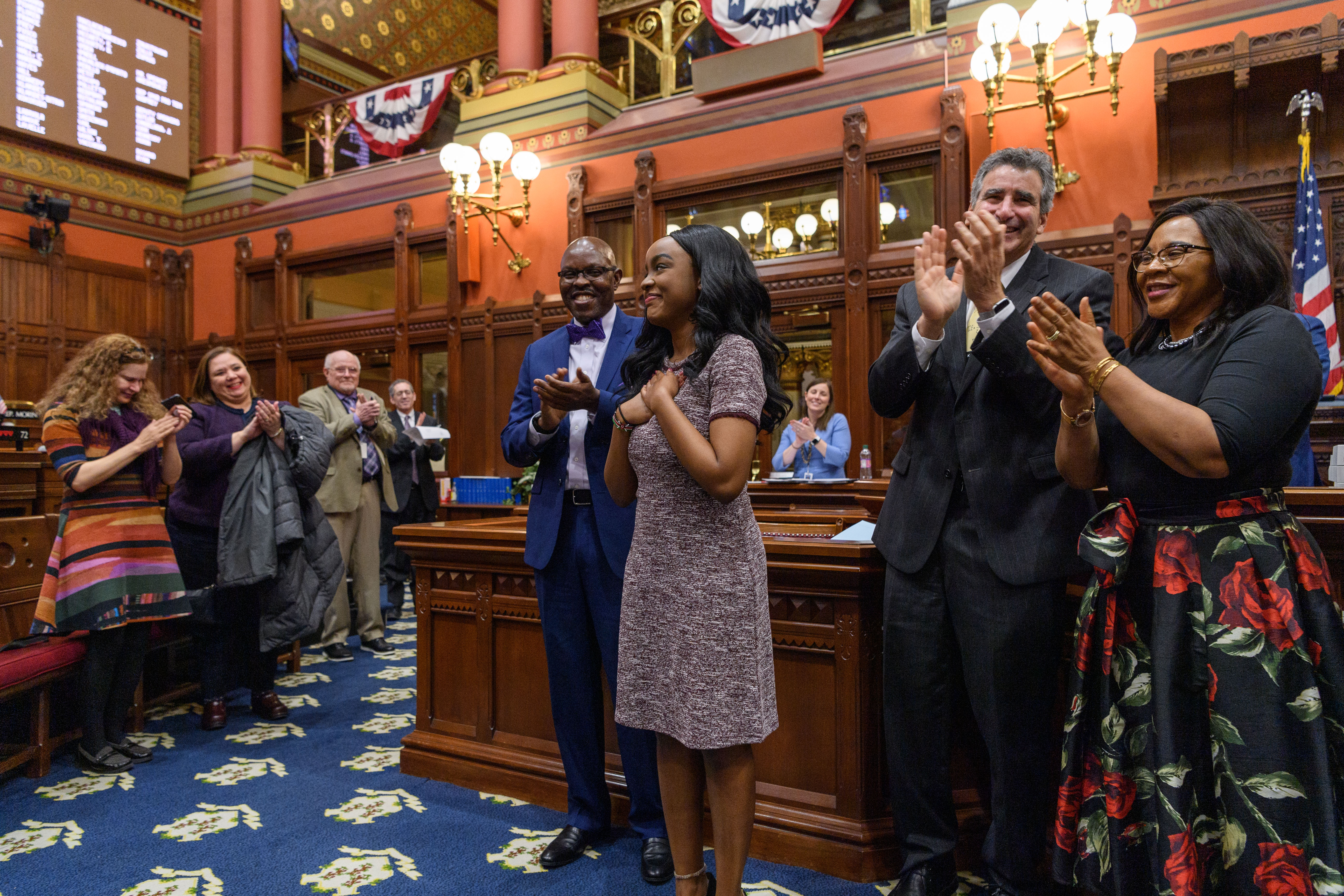 UConn Rhodes Scholar Wawa Gatheru is applauded by state lawmakers in Hartford.