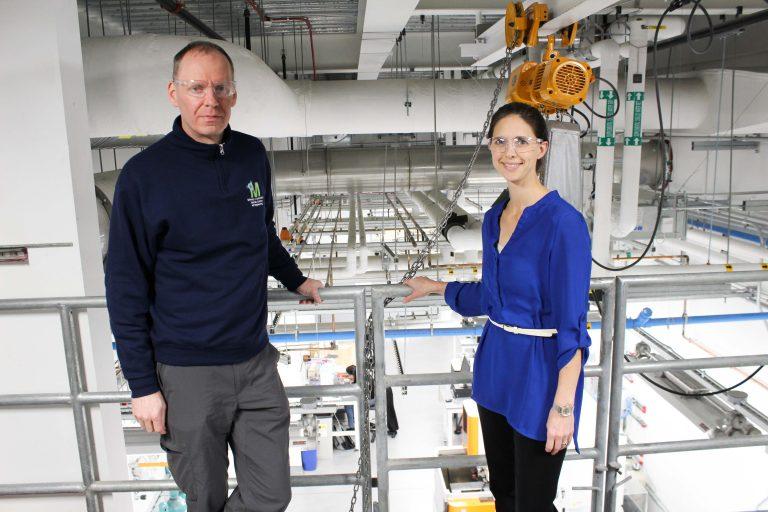 Professors Rainer Hebert and Lesley Frame stand in UConn Tech Park