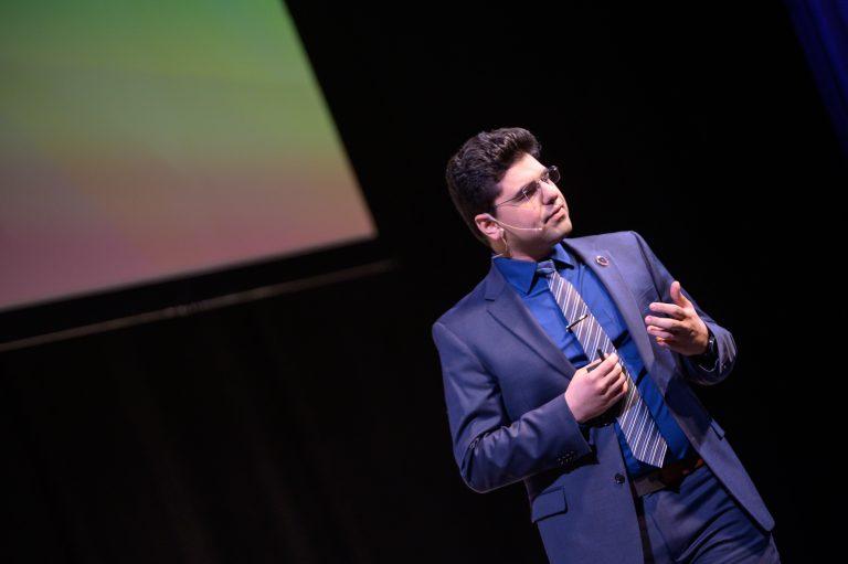 A UConn-connected entrepreneur speaks at a business event in Hartford.