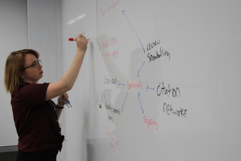 Eliza Grames, a UConn PhD candidate, works on solutions at the Evidence Synthesis Hackathon in Australia in 2019. (Courtesy of Neal Haddaway)