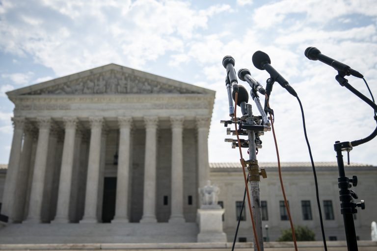 The US Supreme Court building, with microphone stands.