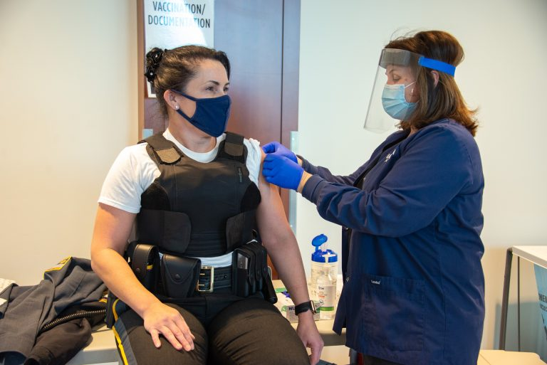 UConn Deputy Chief of Police Maggie Silver receives a vaccine for COVID-19