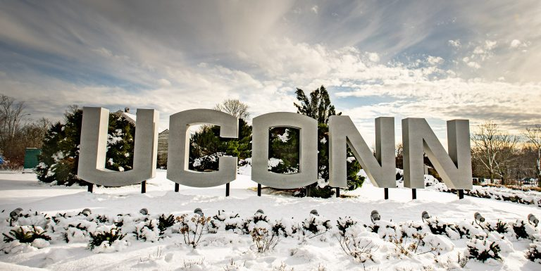 Gateway UConn sign surrounded by snow