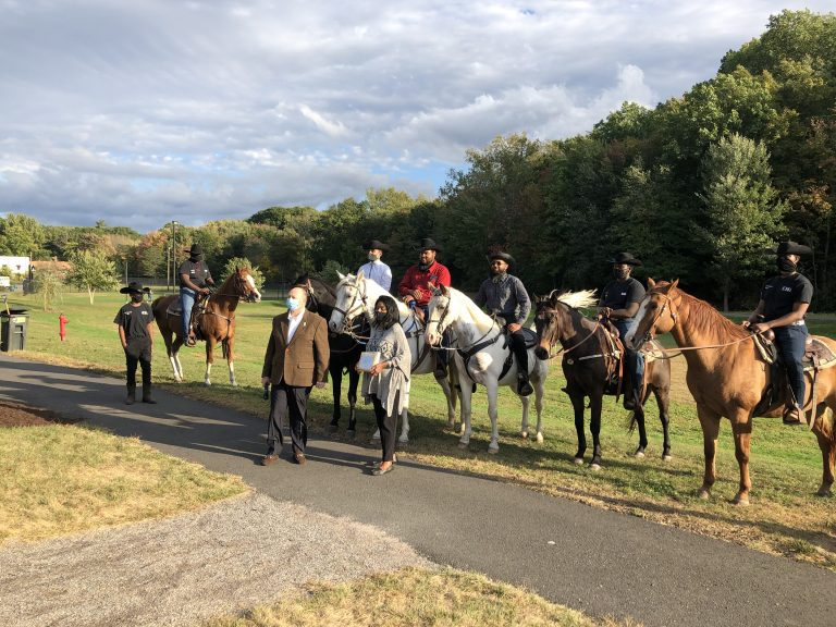 The members of Ebony Horsewomen Inc.'s Junior Mounted Patrol in Keney Park, receiving a Connecticut Greenways award in October 2022, with Ebony Horsewomen founder and CEO Patricia