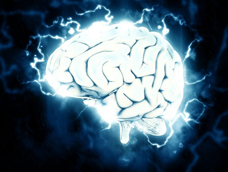 A blue-hued brain with electrical signals