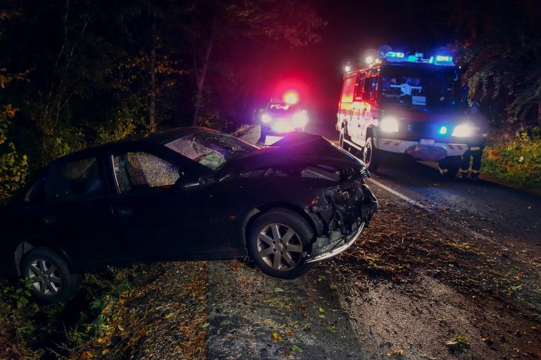 The aftermath of a car crash at night, with emergency vehicles in the background. Although fewer cars are on the road during the pandemic, the number of fatal crashes has actually increased.