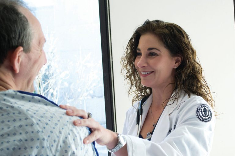 Dr. Rebecca Andrews interacting with patient pre-COVID