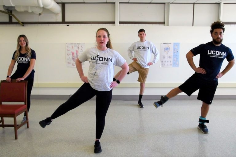 Four students doing exercises