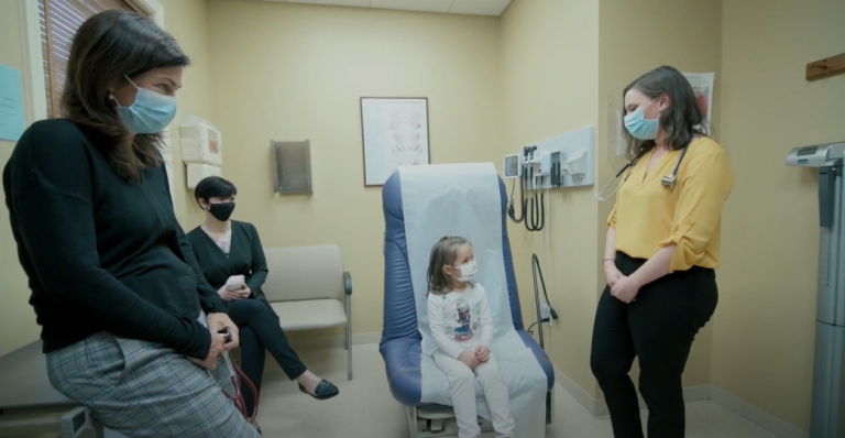 A doctor, a medical student, and a young patient together in an examination room. The UConn CLIC program has been connecting medical students with community providers for 25 years.