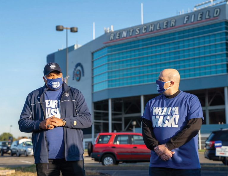 Smith and Jakubowski standing in front of Pratt & Whitney Stadium at Rentschler Field