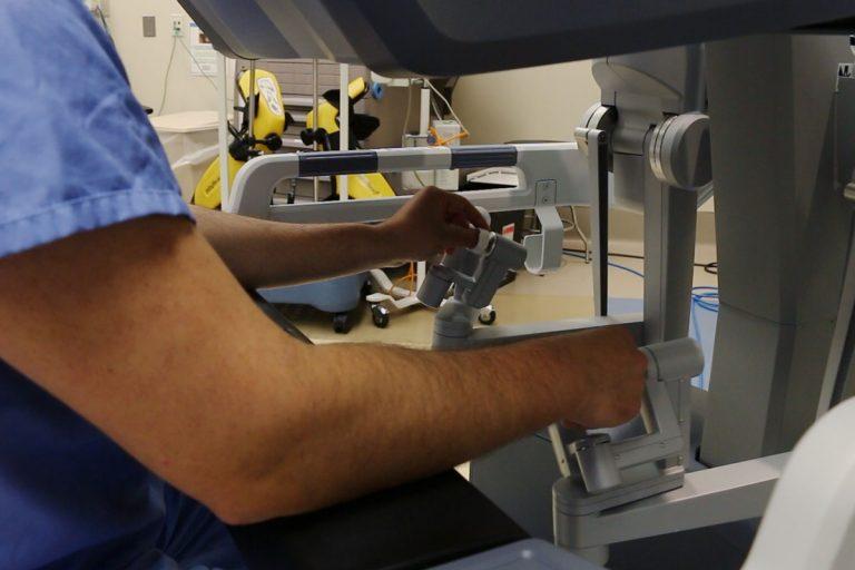 Image of surgoen manipulating robotic surgical tools