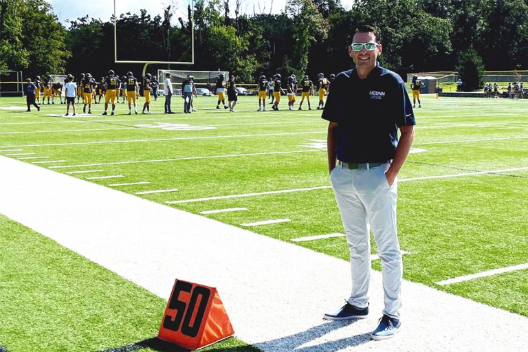 Dr. Zachary Maass on the football sideline