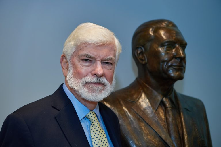 Former Senator Chris Dodd, with the bust of his father at the Thomas J. Dodd Research Center on Sept. 24, 2021.
